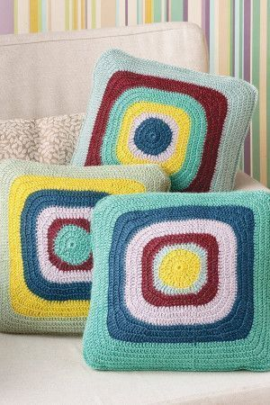3 bright vintage-style crochet cushions with circles within squares