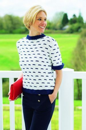 Garter stitch women's top with roll back cuffs