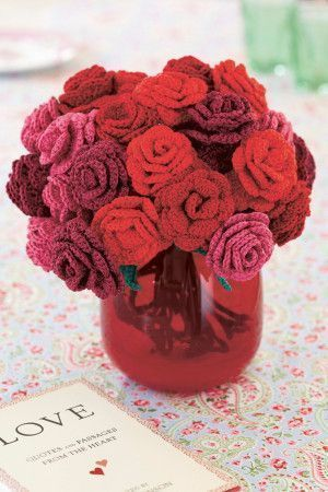 Vase of crocheted roses in two different designs