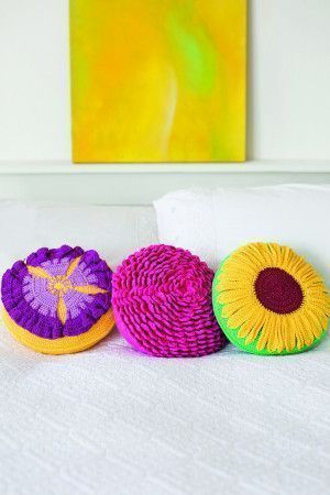 Trio of round crochted flower cushions