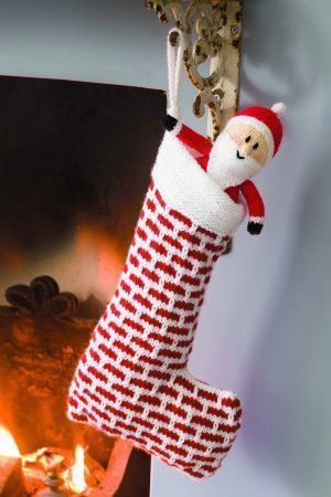 Knitted chimney stocking with Santa toy