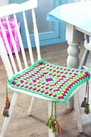 Colourful crochet seat cover with plaited tassels