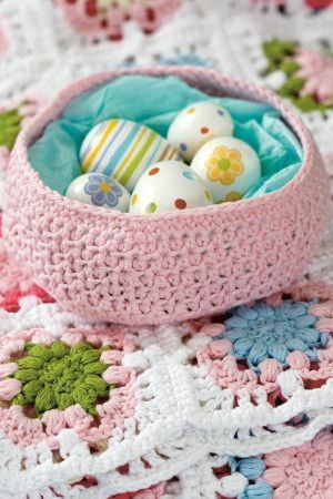 Small crocheted bowl filled with mini Easter eggs