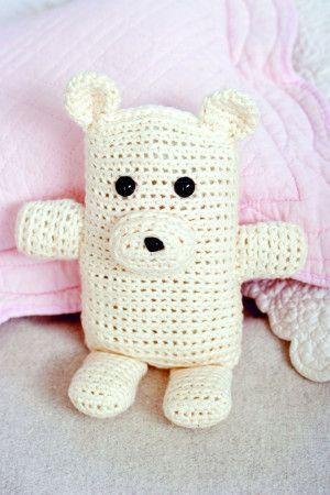 Small crocheted teddy bear for children