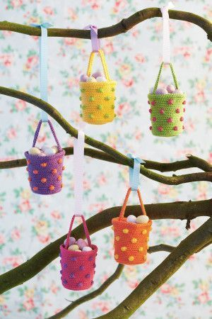 Bobbly crochet hanging baskets filled with mini Easter eggs