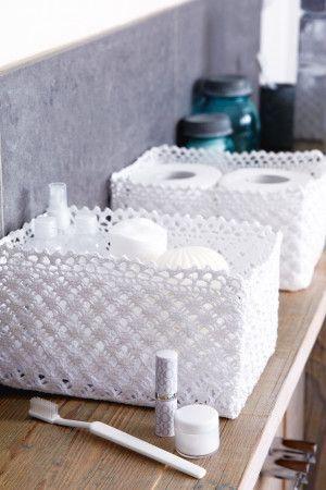 Crocheted white storage baskets