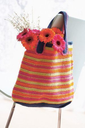 Crocheted bag with multi-colour stripes and blue straps for shopping trips