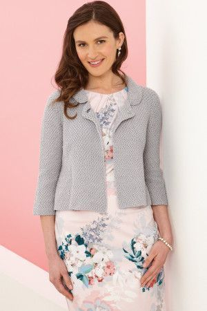 Short knitted jacket with elbow-length sleeves and collar