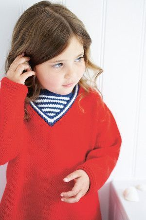 Knitted jumper for a boy or girl with striped V neck inset