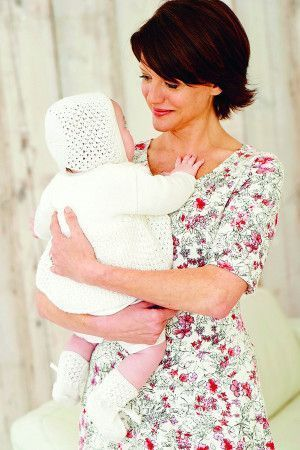 Baby wearing a knitted white textured vintage outfit