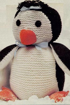 Vintage knitted penguin toy with orange beak