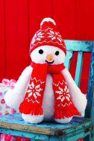 Knitted toy snowman with red scarf and bobble hat