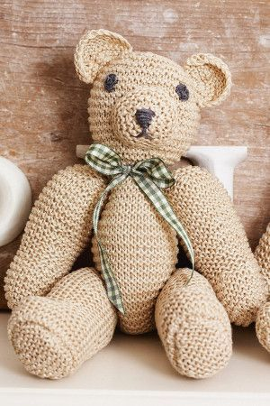 Knitted retro bear from 1960s with chunky arms and gingham bow-tie