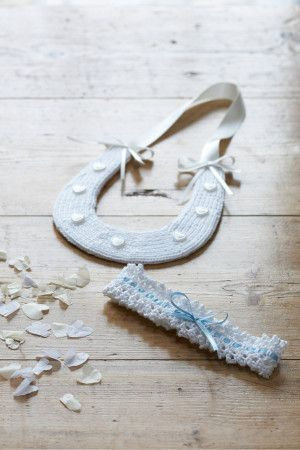 Knitted wedding set of pretty horseshoe and garter with blue ribbon for the bride