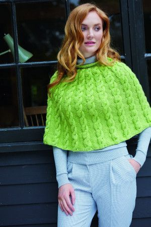 Bright green women's cape with cable knit detail