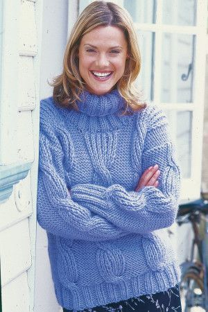 Chunky cable sweater for a woman with roll neck and wide ribbed edge