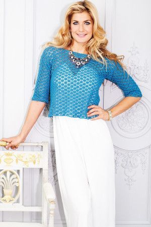 Crocheted ladies' short lacy top with elbow length sleeves