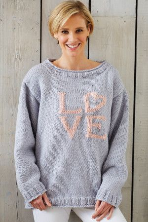 Loose grey knitted ladies' jumper with LOVE in pink worked onto the front