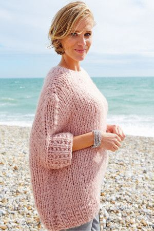 Knitted big yarn ladies' sweater with deep textured cuffs and bottom border