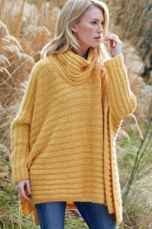 Knitted ladies' poncho with slouchy rolled neck