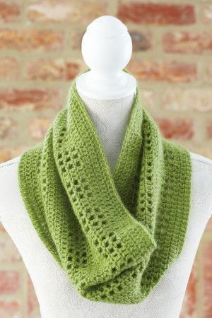 Lightweight crocheted ladies' snood in green with mesh panels