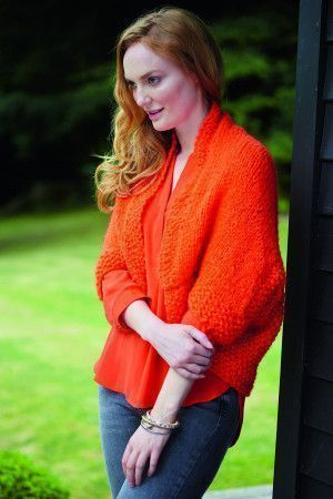 Knitted ladies' shrug top with textured effect