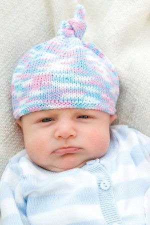 Pastel coloured knitted beanie hat for babies