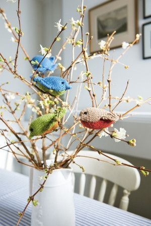 Knitted baby birds in bright spring colours