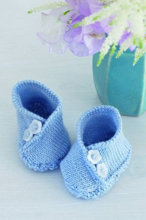 Knitted baby booties with flower buttons