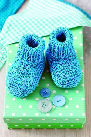 Blue knitted baby booties with roll top