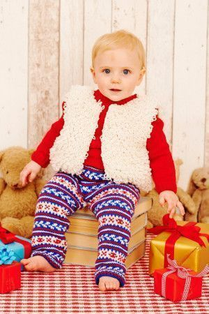Knitted sweater, loopy waistcoat and jazzy patterned leggings for a baby