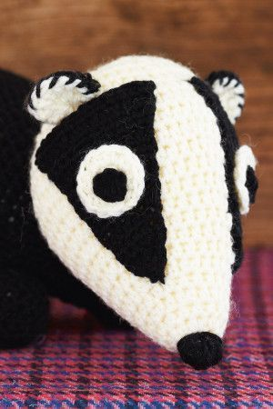 Cute black and cream crocheted badger toy