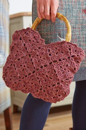 Knitted butterfly-shaped bag with bamboo handles