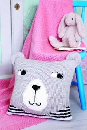 Knitted cushion with bear face motif for kids