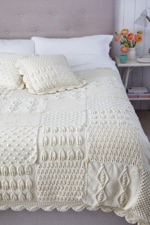 Knitted bed topper and matching cushion