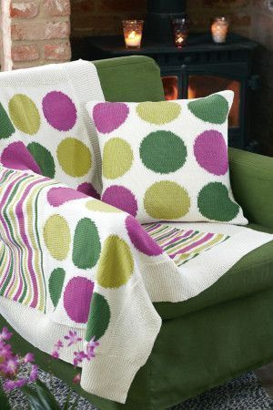 Knitted throw and cushion with spots and stripes
