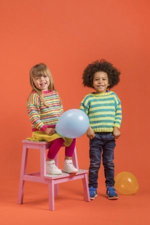 boy and girl wearing striped knitted jumpers