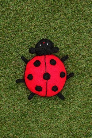 knitted ladybird toy in red and black