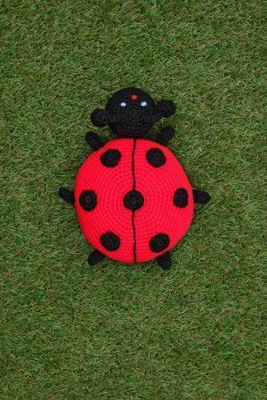 crochet ladybird toy in red with black spots