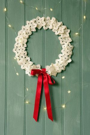 Christmas wreath made from crochet snowflakes and red ribbon