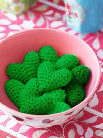 Bowl of crocheted amigurumi hearts