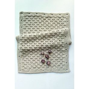 Knitted rectangle that can be turned into different items