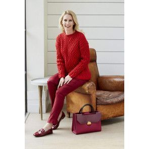 Ladies red asymmetrical cable sweater knitting pattern
