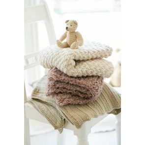 Three knitted baby blankets