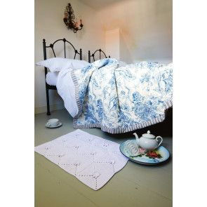 White crocheted bedroom oblong mat with 12 squares