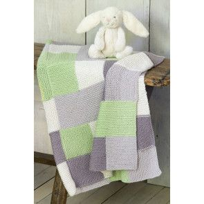 Knitted blanket with green, grey and white squares