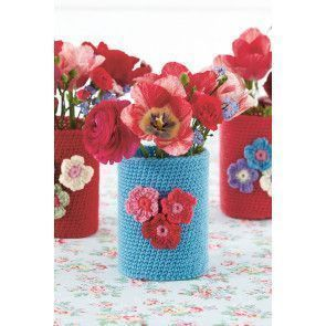 Crocheted vase with flower motif on front