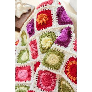 Flower Garden blanket with crocheted daisies
