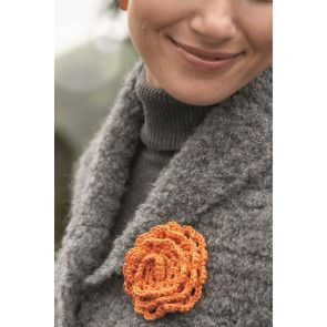 Crochet floral brooch with bright orange to enhance any knit