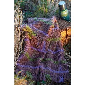 Knitted picnic rug with deep fringe and stripes of contrasting colours